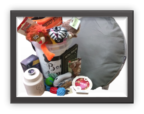 basket filled with dog toys treats and other items