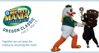 Benny the Beaver and the Duck with the RecycleMania trophy